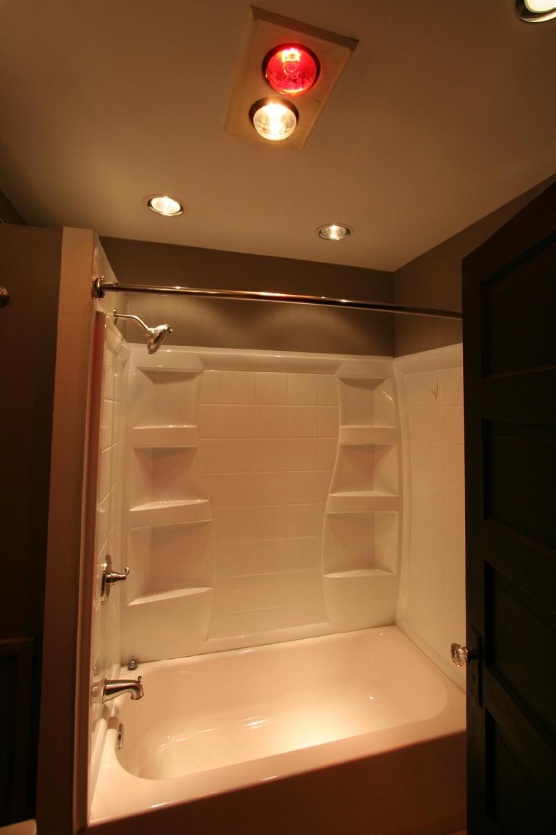 Bathroom Features Dual Heat Lamps And Halogen Lighting